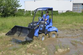 MultiOne-mini-loader-2-series-with-bucket-mud-2-1030x688